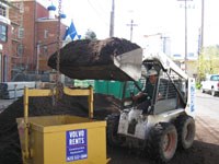 Loading soil into lift bucket